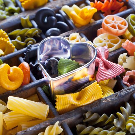 Different colored Pasta in an old letter-box photo