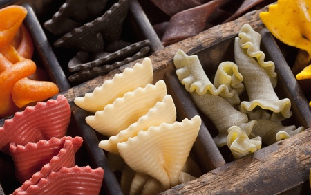 settling: Different colored Pasta in an old letter-box
