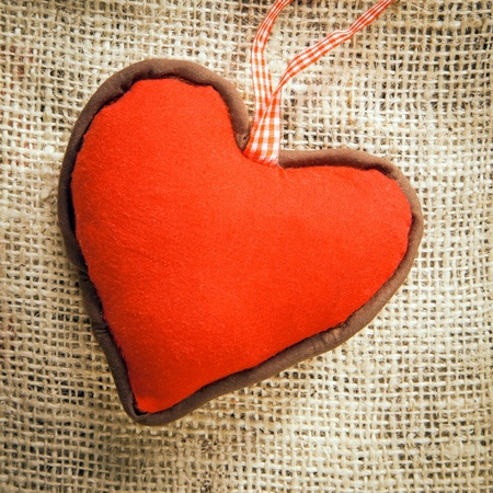 peg board: a red Heart on a textile background