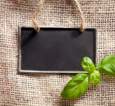 a chalkboard on a textile coffee bag with basil photo