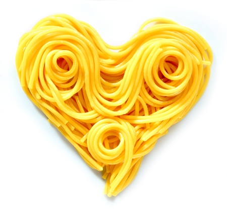 Beauty Pasta Heart. Heart-shaped arrangement of pasta, or spaghetti, isolated on white, concepetual of love and romance. photo