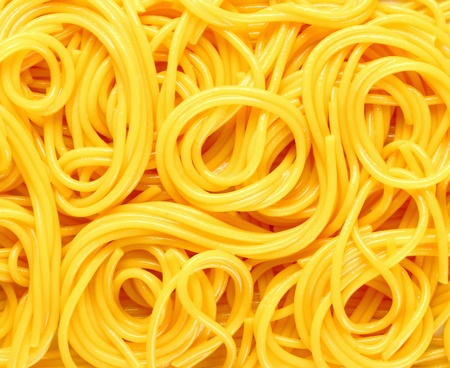 spaghetti: Closeup abstract background of coiled strands of spaghetti pasta