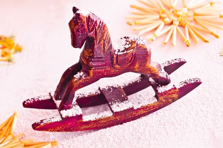 resemble: Christmas red miniature rocking horse sprinkled with powdered sugar to resemble snow.