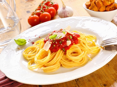 freshly prepared: Plate of freshly prepared spaghetti bolognaise with a tomato sauce and cheese ready to be served.