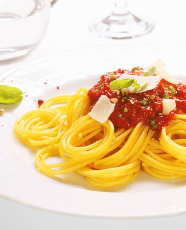 bolognaise: Plate of freshly prepared spaghetti bolognaise with a tomato sauce and cheese ready to be served.