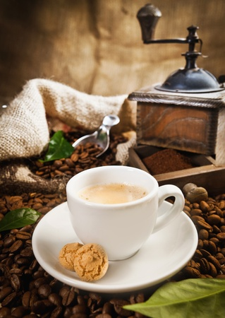 instant coffee: Cup of coffee, fresh brewed with beans and a coffee grinder in the background Stock Photo