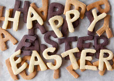 scrumptious: Easter Biscuit background of scrumptious freshly baked alphabet biscuits spelling the words Happy Easter