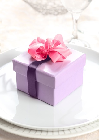 violet Present or Gift Box with a pink bow and a lilac ribbon photo