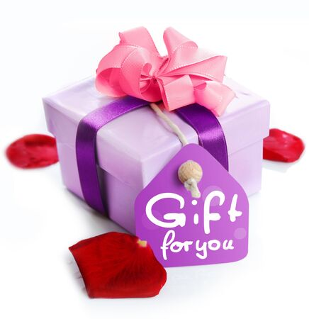 extra: violet Gift Box with a card, a ribbon and the words Gift for you. Red Rose leaves isolated on white background Stock Photo