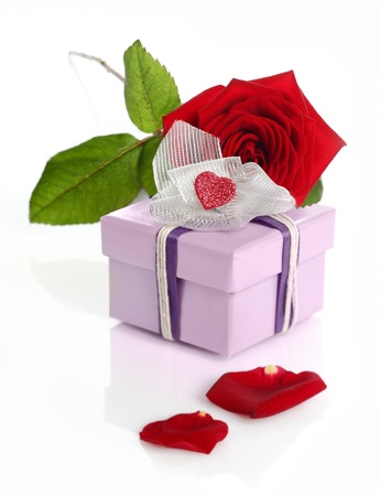 Red roses and gift box isolated on white background photo