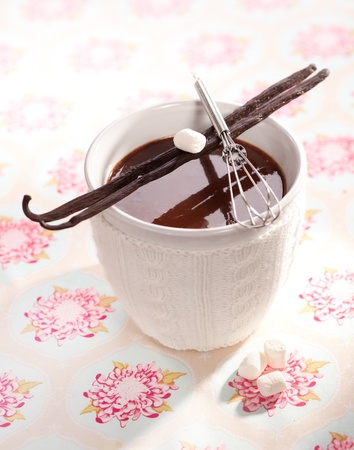Sweet hot Cacao with Marshmallows and vanilla sticks on a decorative background  photo