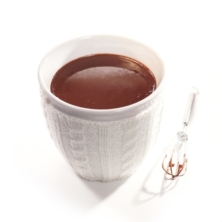 White ceramic cup filled with thick delicious melted chocolate that has been whisked photo