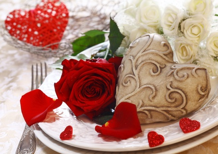 Place Setting with a place card, red and white roses and a heart photo
