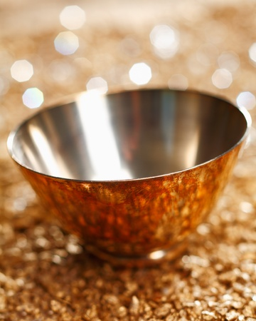 buffed: Stylish empty silver bowl with reflections and a background bokeh of twinkling party lights