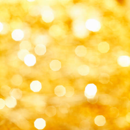out of focus: Square background bokeh of sparkling golden festive lights at a celebration Stock Photo