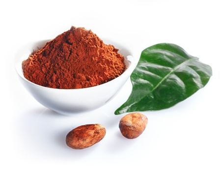 Cacao beans, leaf and cacao powder isolated on white photo