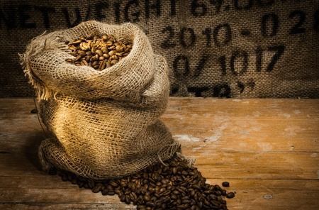 Hollow woven bag full of coffee under beautiful lighting photo