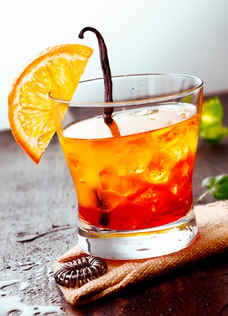 Cocktail Tequila sunrise on a wooden background with Orange Fruit, juice and some fresh leaves Stock Photo - 13037933