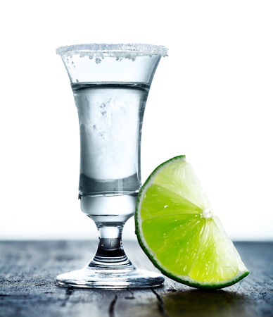 tall glass: Tall glass with Margarita drink, salted rim and lime. Stock Photo