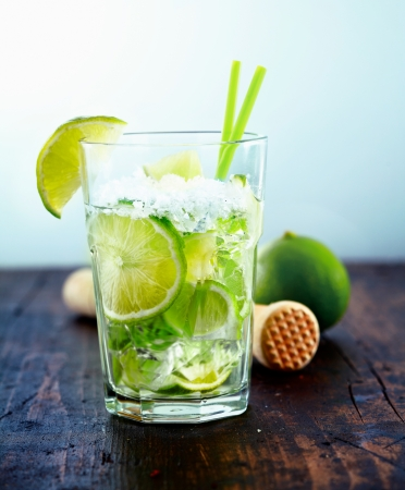 Refreshing cold Caipirinha with fresh lime slices and ice. Stock Photo