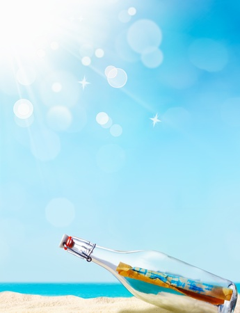 message in bottle: Message in a bottle illustrated with a beautiful sand beach in the background