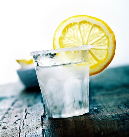 cooled: Cooled Tequila with a fresh Citron and salt on a wooden background