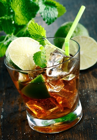 Cuba Libre Drink with lime and Cola,on a wooden plate photo