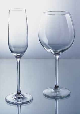Empty wine and champagne glass with reflexion. photo