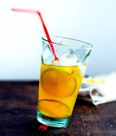 non alcoholic: Juicy Drink with a straw on a wooden, ancient plate