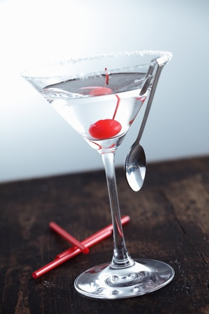 Dry Martini with a cherry on a aged background Stock Photo - 13179776