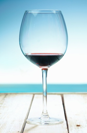 A Glass of Wine at the beach, standing on a footbridge in the south pacific. For your potable concepts take a look at my portofolio. Stockfoto