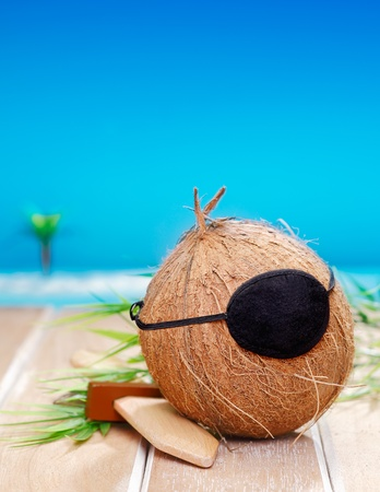 Coconut Pirate with an eye patch, for kids carnival and vacation concepts. photo