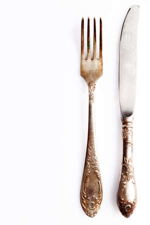 comprising: Silver cutlery setting comprising a knife anf fork on white with empty placement space for your food or text