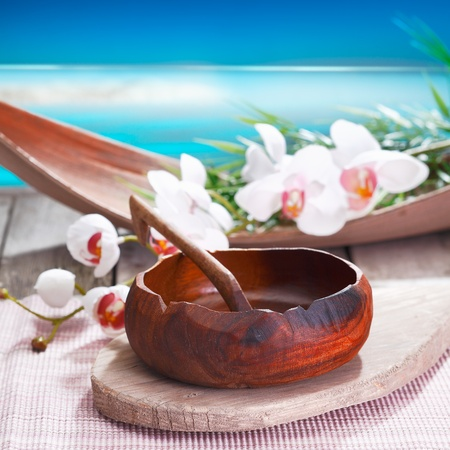 phalaenopsis: Exotic white orchids and an ethnic handcrafted bowl lend a different air to this spa treatment alongside the water