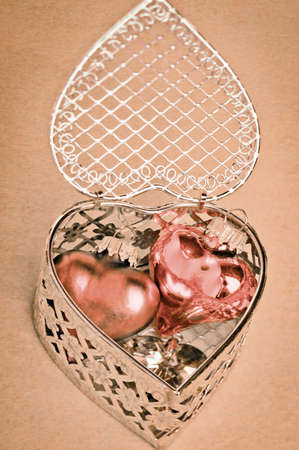nestled: Valentines or anniversary gift of romantic hearts nestled inside a delicate silver filigree heart-shaped gift box