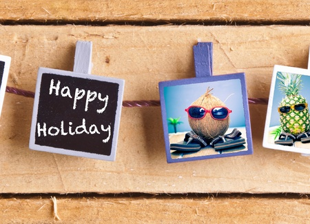 Happy Holiday snaps on a line of cool fruity friends, a coconut and pineapple, enjoying the tropics in their sunglasses and slip slops Stock Photo - 13385302