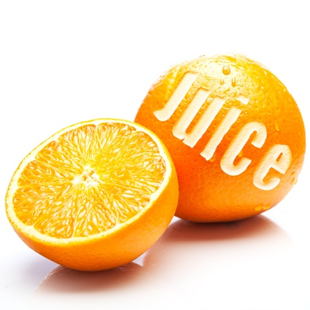 A whole fresh orange with the word Juice incised in the rind together with a halved orange showing ripe juciy pulp in an orange juice concept Zdjęcie Seryjne