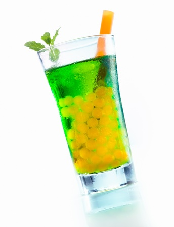 Mango Boba tea with mint bubbles and woodruff syrup isolated on white background