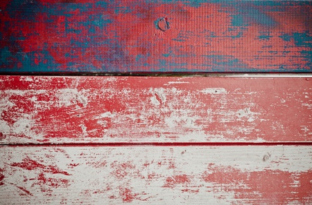 Grunge painted wooden texture background with red paint peeling off weathered timber planks with woodgrain Stock Photo - 13499097