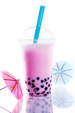 kiddies: Healthy pink berry bubble tea with a good head of froth or bubbles from shaking and colourful purple boba