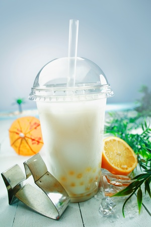 pearl tea: Milky bubble tea blended with fresh orange fruit and boba or tapioca balls served at the sea