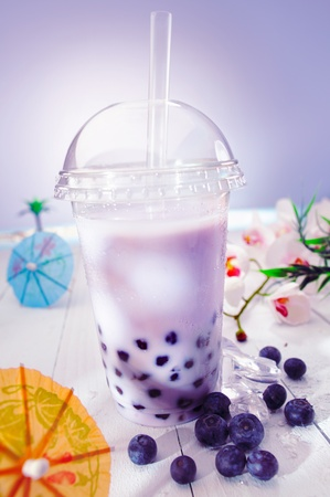 pearl tea: Bubble tea blended with milk and black currant berries and purple boba or pearls
