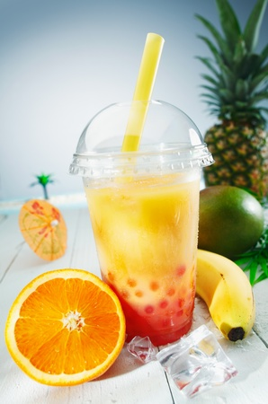 scheduled: Healthy bubble tea tropical fruit smoothie with banana, mango, pineapple and orange blend Stock Photo