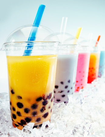 pearl tea: Assorted Fruity Boba Tea Cocktails in a row on crushed ice