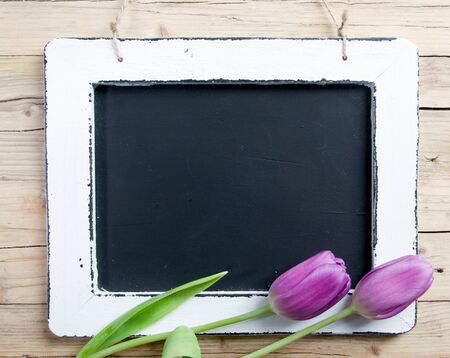 Blank Message board with lilac flower and copy space. photo