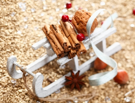 A Christmas sledge full of herbs and nuts on a festive background. Whole series in my Portfolio Stock Photo - 13766627
