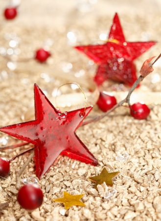christmas ground: Red vitreous Christmas stars and two golden on a festive christmas background Stock Photo