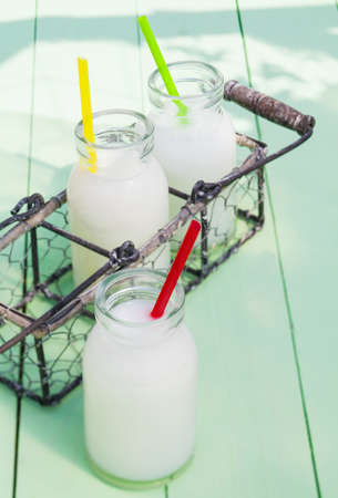 Some milky drinks in a tray for lunch time outdoors photo