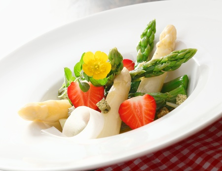 starter: Salad of freshly diced asparagus tips and strawberries served in a plain white dish