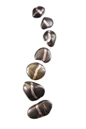 Spinal shaped hot stones. Different rocks isolated on white background.